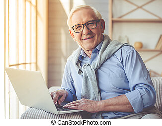 Handsome old man at home - Handsome old man dressed in smart...