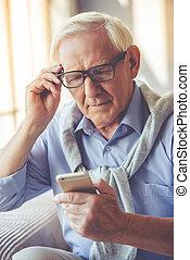 Handsome old man at home - Handsome old man dressed in smart...