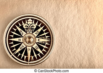 Compass on the old paper