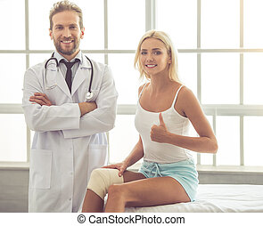 Doctor and patient - Handsome medical doctor and beautiful...
