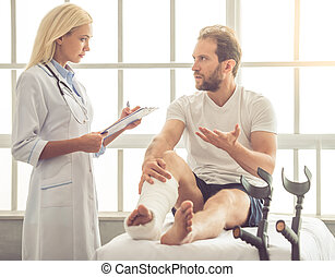 Doctor and patient - Beautiful female medical doctor is...