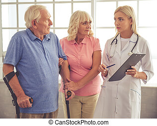 Doctor and old people - Beautiful young female doctor is...