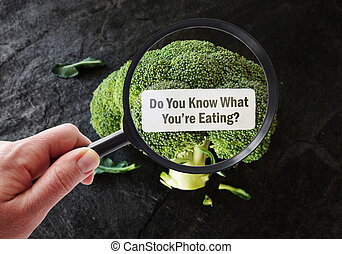 Magnified What You're Eating food label - Hand with...