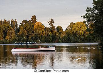 Pleasure boat on mere at Ellesmere Shropshire - Old wooden...