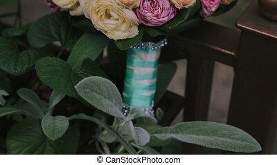 A wedding bouquet near the flowerpot in full HD