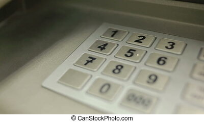 woman hand touching ATM machine gaining password - Human...