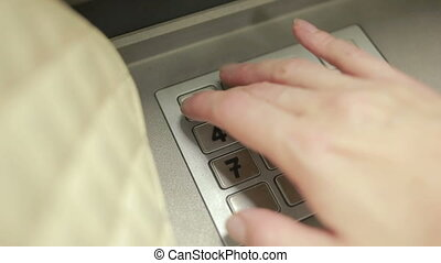 woman hand touching ATM machine. gaining password.