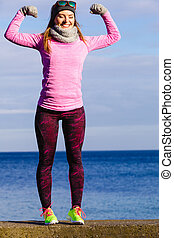 Woman fitness sport girl training outdoor in cold weather -...