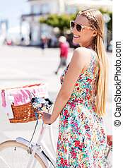 Portrait of a pretty woman on bicycle