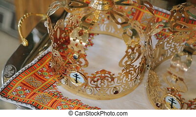 Close up of two wedding crowns prepared for ceremony of...