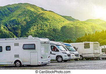 RV Park Camping. Modern Camper Motorhomes in the RV Park.