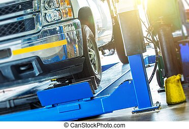 Car Wheel Alignment Check. Large Pickup Truck on the...