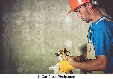 Pro Construction Worker Preparing For His Job Construction...