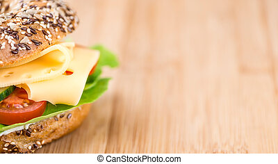 Bagel (with Gouda cheese) on vintage looking background...