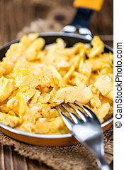 Pan with scrambled Eggs (selective focus) - Pan with fresh...