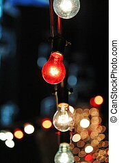 Decorative outdoor string lights hanging at night time fairy