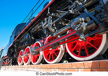 steam train - red wheels of steam train