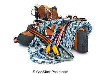 climbing and hiking gear - carabiners, ropes and boots -...