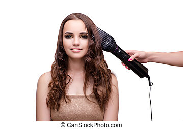 Beautiful woman getting her hair done with hair dryer...