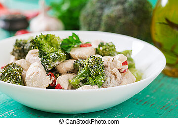 Delicate saute chicken with broccoli and chili peppers in a...