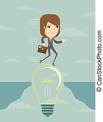Businesswoman on a lightbulb cross an abyss.