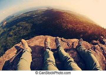 hiking legs enjoy the view on mountain peak