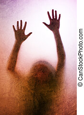 Trapped woman, back lit silhouette of hands behind matte...
