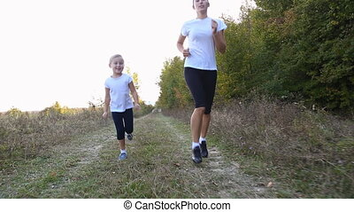 Mom and daughter running outdoors