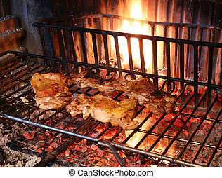 cooking the meat grilled chicken in the large fireplace