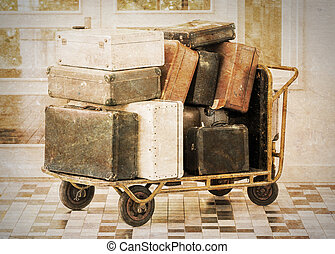 Trolley full of old luggage, vintage setting