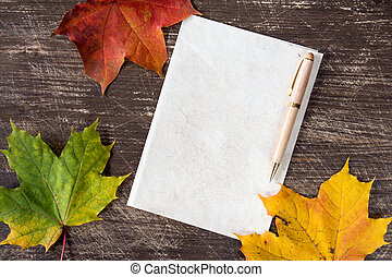 Withered leaves and blank paper page