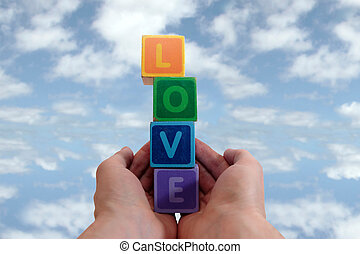 outstretched hands of love - childrens toy letters in...
