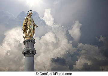 Virgin Mary Statue - A statue of the Virgin Mary with storm...
