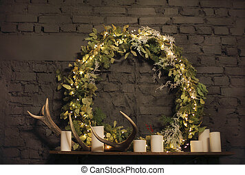 Christmas wreath above mantel on brick wall background with...