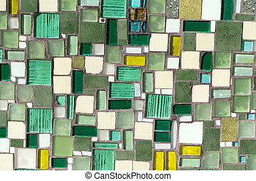 Colorful mosaic on the wall, abstract glass background.