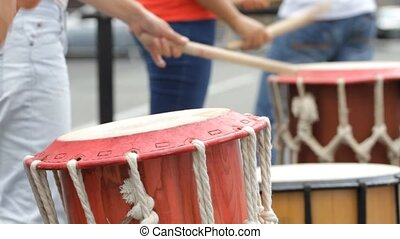 Musicians playing on drums - Group of musicians playing on a...