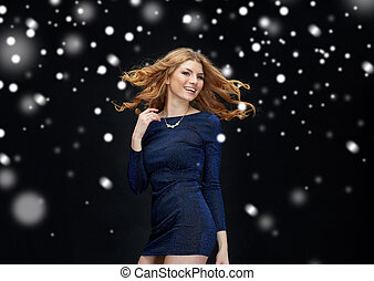 happy young woman dancing over snow - new year party,...