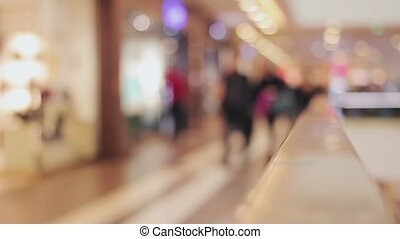 Blurred background shopping mall. People pass by, shoping....