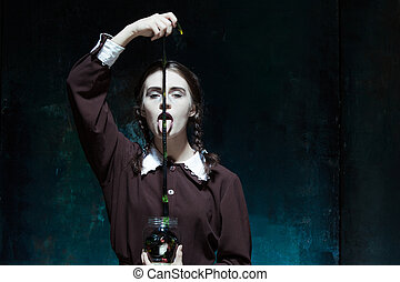 The Halloween theme: crazy girl with snakes