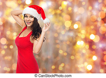 beautiful sexy woman in santa hat and red dress