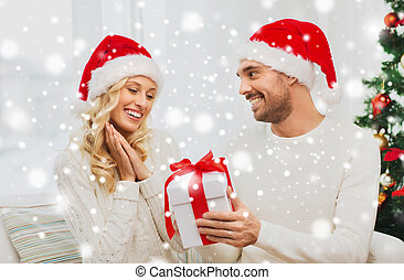 happy couple at home with christmas gift box - christmas,...