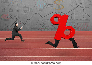 Man running after 3D red percentage sign with human legs, on...