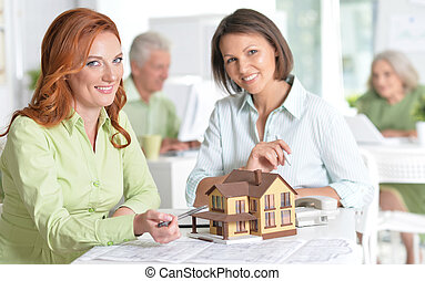 Female house agent and customer - Portrait Of working...