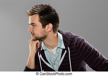Profile Portrait of Young Man thinking