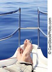 boat bow man feet blue sea view sailing ocean relaxed calm...