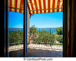 Beautiful view to sea from the inside of apartments. Balcony...