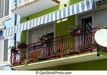 House with balcony on sea resort, sunny day, touristic...