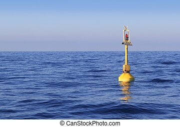floating yellow beacon blue sea ocean in Mediterranean