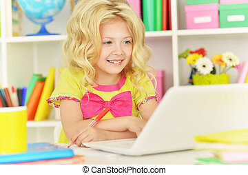 student girl  with books and laptop