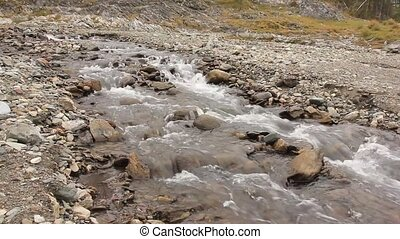 Small mountain river. Landscape with stream flowing between rocks